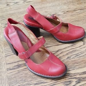 Born red leather Mary Jane pump heels.